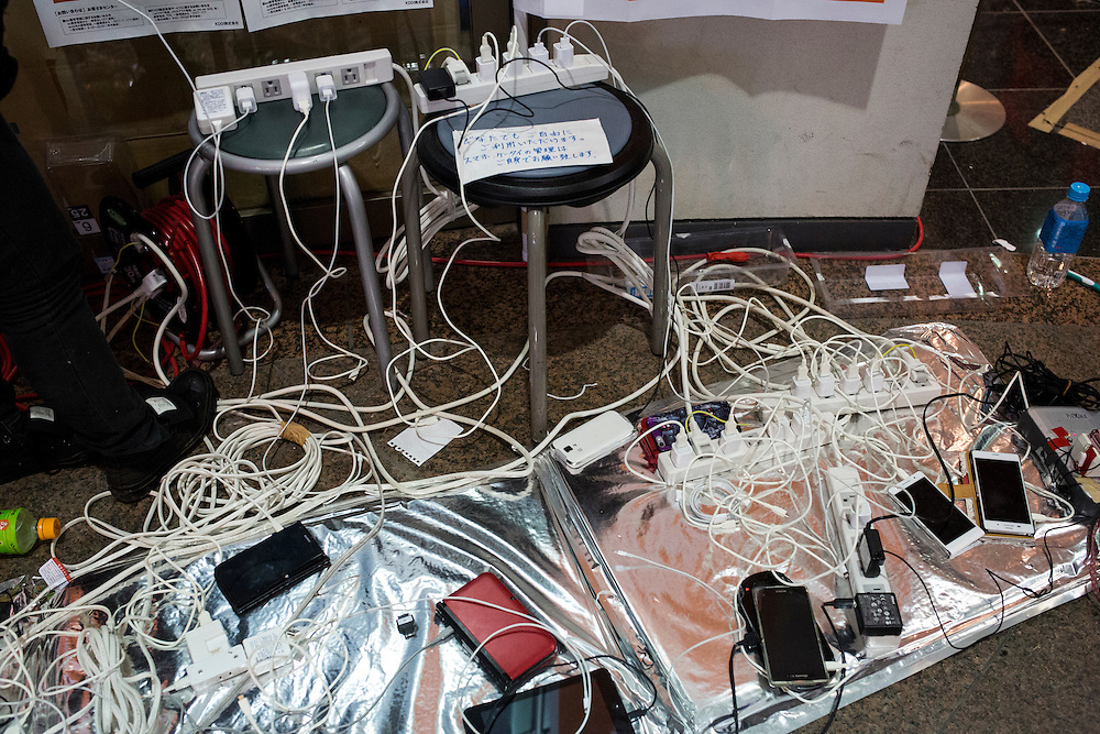 KUMAMOTO, JAPAN - APRIL 21:  Mobile phones are charge in the morning of April 21, 2016 in Mashiki Gymnasium evacuation center  Kumamoto, Japan. To date 45 people are confirmed dead and around 11,000 people have evacuated after an 6.5 earthquake on Thursday night and a stronger 7.3 quake on Saturday morning struck the Kyushu Island in western Japan.<br /> <br /> Photo: Richard Atrero de Guzman
