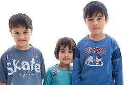 Portrait of three children in the studio,