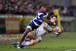 Duncan Taylor (Saracens) is tackled by Semesa Rokoduguni (Bath) - Photo mandatory by-line: Patrick Khachfe/JMP - Tel: Mobile: 07966 386802 28/02/2014 - SPORT - RUGBY UNION - The Recreation Ground, Bath - Bath v Saracens - Aviva Premiership.