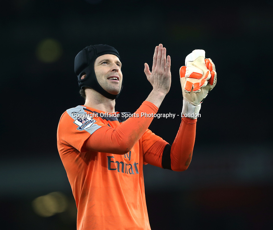 28 December 2015 - Premier League - Arsenal v AFC Bournemouth :<br /> Arsenal goalkeeper Petr Cech celebrates another clean sheet.<br /> Photo: Mark Leech