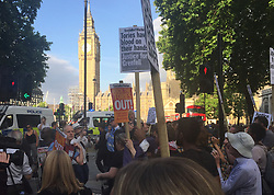 Protesters in Westminster, London demanding answers and justice over the Grenfell Tower disaster.