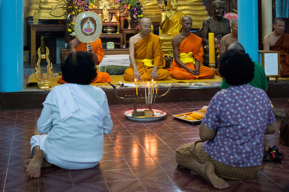 Members of the congregation pray with monks on Makha Bucha Day in Nakhon Nayok, Thailand.