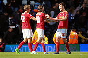 Nottingham Forest midfielder Henri Lansbury (10) and Nottingham Forest midfielder Robert Tesche (32) celebrating with Nottingham Forest midfielder Gary Gardner (22) during the Sky Bet Championship match between Fulham and Nottingham Forest at Craven Cottage, London, England on 23 April 2016. Photo by Matthew Redman.