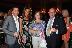 Left to right, STUART SUTHERLAND, his fiance ASHUMI SANGHVI, MUIR & MERCEDES SUTHERLAND the men are producers of TV's Sharpe's Peril at a reception hosted by the Spanish Ambassador for the Anglo-Spanish Society at The Spanish Embassy, Belgrave Square, London on 29th June 2011.