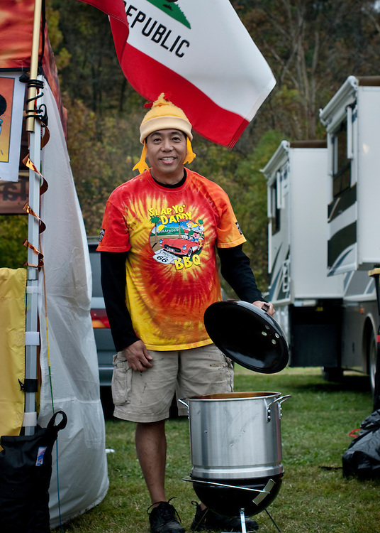 Harry Soo from Slap Yo' Daddy BBQ with his converted kettle grill that he intends to win a competition with. He claims it's all about the pit master and not the pit...Jack Daniels Invitational Barbecue 2012 - The Jack. .Photographer: Chris Maluszynski /MOMENT