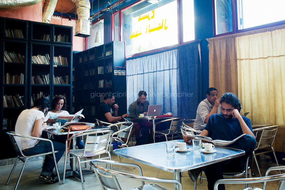 TUNIS, TUNISIA - 26 JULY 2013: Customers read newspapers and work on their laptops at the cafe L'Etoile du Nord in Tunis, Tunisia, on July 26th 2013.<br /> <br /> L&rsquo;Etoile du Nord, besides being a cafe, is also an experimental theater that never closes, a free-wheeling space for spectators and performers, and a haunt for actors, intellectuals, free-thinkers and revolutionaries.<br /> <br /> Tunisian actor and theater director, Noureddine El Ati, who founded the theater company in 1997, says the venue is unique in all of North Africa.