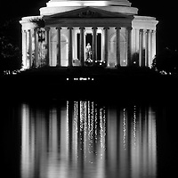 Jefferson Memorial Illuminated at Night with reflection in the Tidal Basin, Washington DC, USA