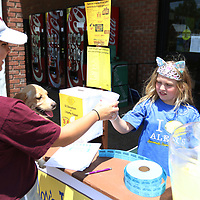 Ryleigh Wright, 8, hands Kazzie Ellenburg a lemonade Saturday in front of Todd's Big Star for her Alex's Lemonade Stand to raise money for St. Jude Children's Research Hospital