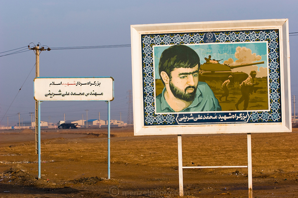 A picture of Mohammed Ali Sharifi is displayed on an Iran-Iraq War martyr billboard near Yazd, Iran. A portion of the Yazd to Na'in highway is named after him