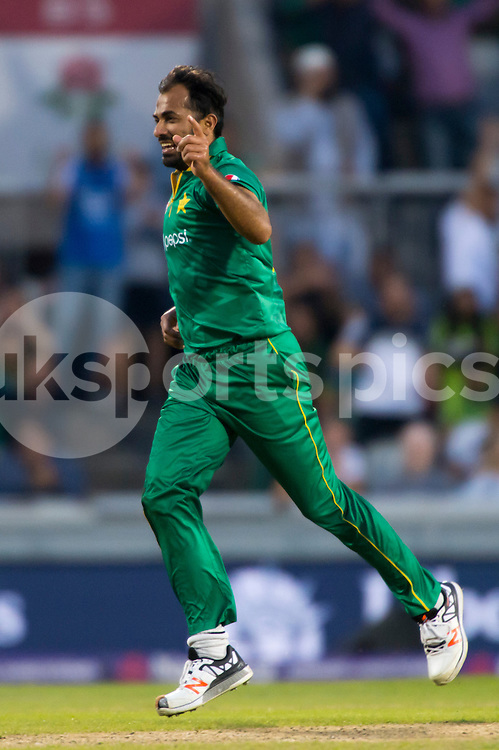 Wahab Riaz of Pakistan celebrates taking the wicket of Eoin Morgan of England who gets caught behind off his bowling during the NatWest International T20 match between England and Pakistan at Emirates Old Trafford, Manchester, England on 7 September 2016. Photo by Brandon Griffiths.