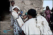 "Zennahu, 3 years old, is being married, with a young guy, 13 years older. In some cultures, arranged marriage is a tradition handed down through many generations. Parents who take their son or daughter's marriage into their own hands have themselves been married by the same process. Child marriages are typically made for economic or political reasons. North West of Ethiopia, on monday, Febrary 16 2009.....In a tangled mingling of tradition and culture, in the normal place of living, in a laid-back attitude. The background of Ethiopia's ""child brides"", a country which has the distinction of having highest percentage in the practice of early marriages despite having a law that establishes 18 years as minimum age to get married. Celebrations that last days, their minds clouded by girls cups of tella and the unknown for the future. White bridal veil frame their faces expressive of small defenseless creatures, who at the age ranging from three to twelve years shall be given to young brides men adults already...To protect the identities of the recorded subjects names and specific places are fictional."