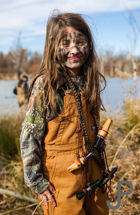Madeline Osborne holds her dad's duck calls.  She prefers duck hunting with her dad rather than watching cartoons on Saturday morning.