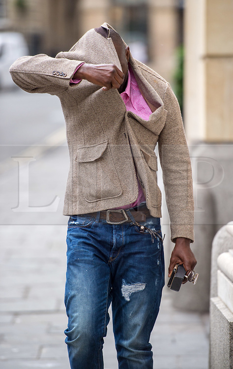 © Licensed to London News Pictures.  13/06/2018; Bristol, UK. Defendant IKE OBIAMIWE Ike Obiamiwe arrives at Bristol Crown Court in connection with the Bulmer art burglary. Eleven men appeared at court charged with offences including conspiracy to burgle and conspiracy to receive stolen goods, linked to the theft of millions of pounds of artwork and jewellery from the Bulmer cider-making family's luxury home. The 11 men are: Liam Judge, Matthew Evans, Skinder Ali, Jonathan Rees, Donald Maliska, Mark Regan, David Price, Ike Obiamiwe, Thomas Lynch, Nigel Blackburn, Azhar Mir. Paintings worth £1.7m and jewellery worth £1m were stolen from Esmond and Susie Bulmer's home in Bruton, Somerset, in 2009. Most of the paintings stolen during the burglary, such as Endymion by 19th Century painter George Frederic Watts have since been recovered. Photo credit: Simon Chapman/LNP