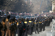 Barack Obama's motorcade heads up Pennsylvania Avenue to the Capitol.