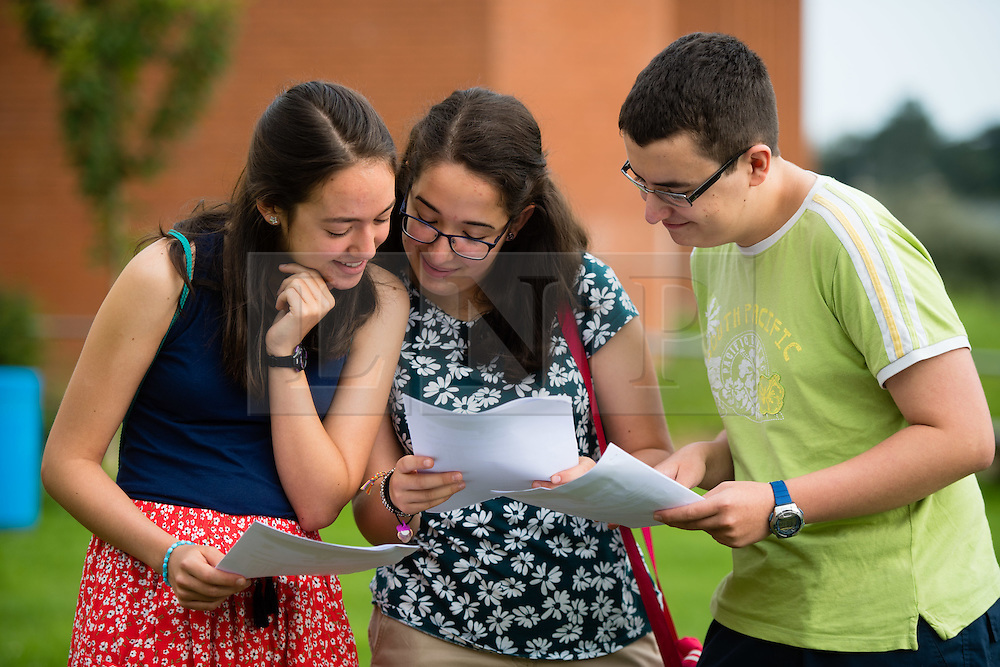 © Licensed to London News Pictures. 25/08/2016. Aberystwyth, Wales, UK. Triplets Ana, Irene and Antonio Barriga, teenage students at Penglais school Aberystwyth Wales UK  celebrating after collecting their GCSE results. The three achieved a clean sweep of A and A* in their exams. Overall in Wales the GCSE A* to C pass rate has remained static  at 66.6%  for the third consecutive  year.  Photo credit: Keith Morris/LNP