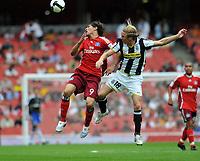Photo: Tony Oudot/Richard Lane Photography.  Juventus v SV Hamburg. Emirates Cup. 03/08/2008. <br /> Jose Paolo Guerrero of Hamburg goes up for a header with Christian Poulsen of Juventus