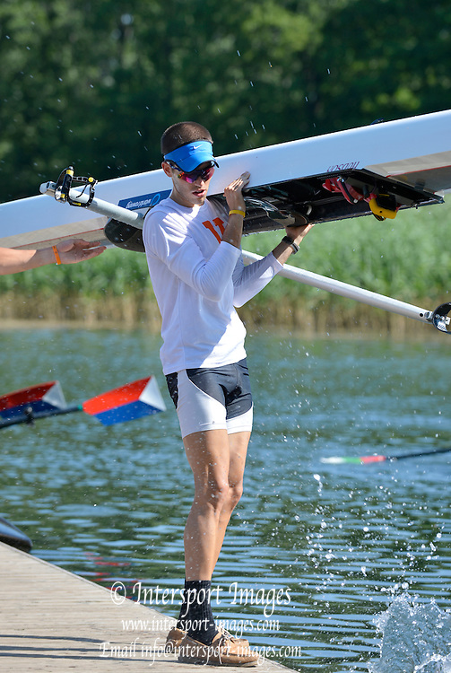 Trackai. LITHUANIA.  USA LM1X. Jonathan FURLONG, returning from a training sessions on Lake Galve. 2012 FISA U23 Rowing Championships, Wednesday 11/07/2012 [Mandatory credit: Peter Spurrier/Intersport Images]..Rowing, U23, 2012.
