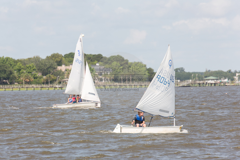 Children sail Opti dinghies at the James Island Yacht Club on Charleston Harbor June 26, 2013 in Charleston, South Carolina.