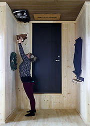 An employee stands in the hallway in 'The Upside Down House', a zero-gravity illusion experience, in The Triangle in Bournemouth, Dorset.