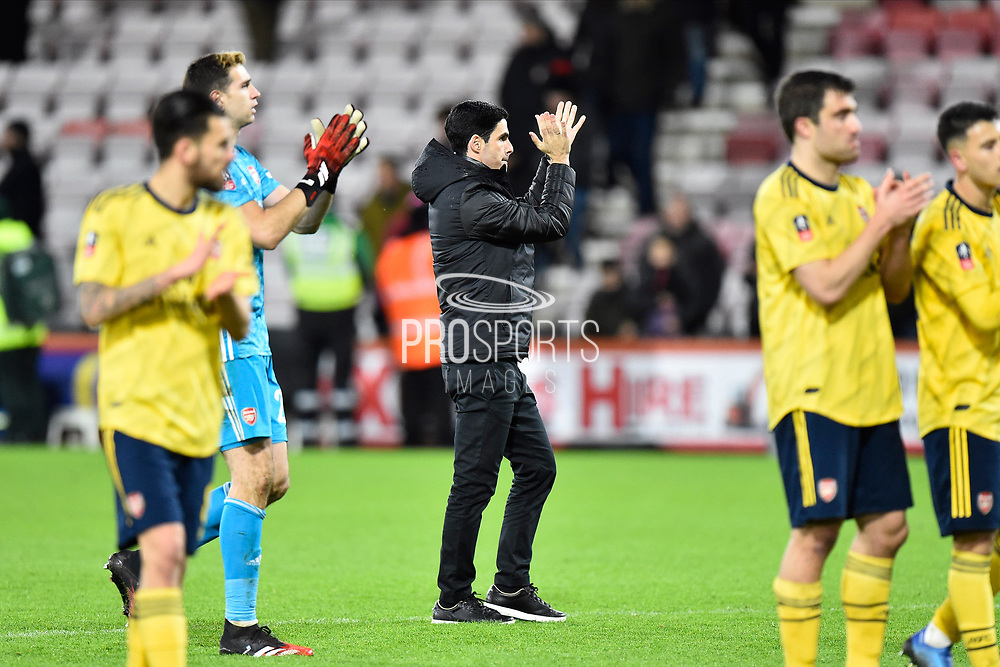 Arsenal manager Mikel Arteta celebrates the 2-1 win at full time with his players during the The FA Cup match between Bournemouth and Arsenal at the Vitality Stadium, Bournemouth, England on 27 January 2020.