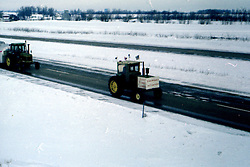 American Agriculture Movement - Tractors to Washington DC crossing McLean County, Illinois following a hard winter storm.  Route took them down I-74 in February 1979.<br /> <br /> This image was scanned from a slide, print or transparency.  Image quality may vary.  Dust and other unwanted artifacts may exist.