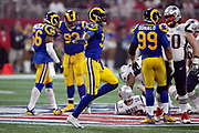 Los Angeles Rams inside linebacker Cory Littleton (58) waves his arms as he celebrates after breaking up a fourth quarter pass and forcing a punt on a third down play during the NFL Super Bowl 53 football game against the New England Patriots on Sunday, Feb. 3, 2019, in Atlanta. The Patriots defeated the Rams 13-3. (©Paul Anthony Spinelli)