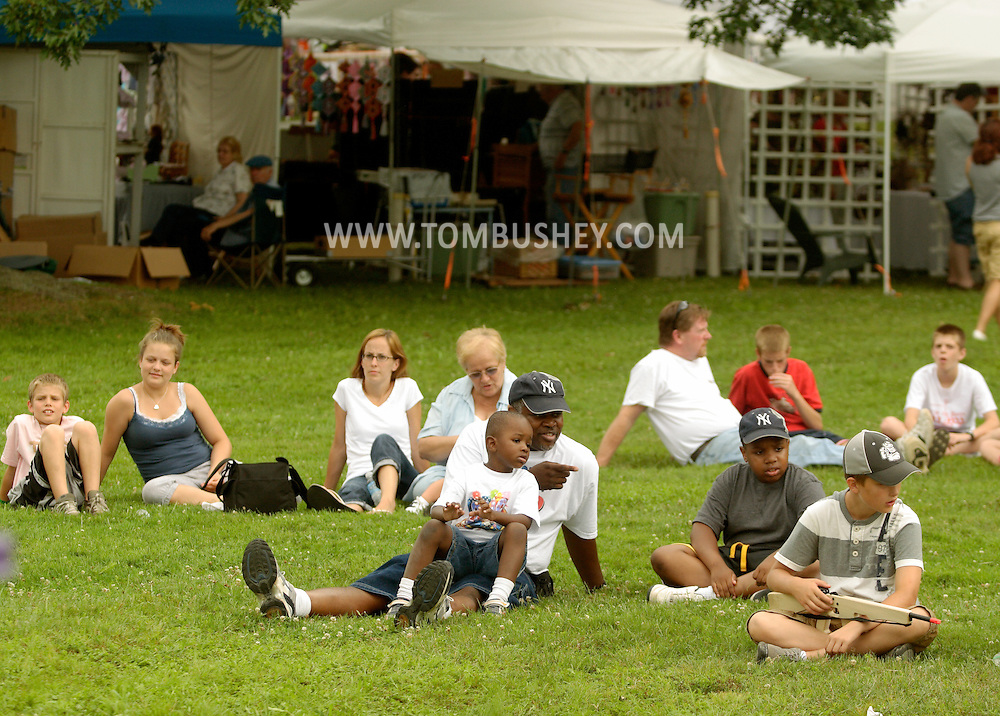 Goshen, NY - People wait for entertainment to start at the Great American Weekend festival on July 5, 2008.