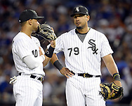 CHICAGO - JULY 27:  Yoan Moncada #10 and Jose Abreu #79 of the Chicago White Sox meet during a pitching change during the game against the Chicago Cubs on July 27, 2017 at Guaranteed Rate Field in Chicago, Illinois.  (Photo by Ron Vesely) Subject:   Jose Abreu; Yoan Moncada