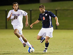 Virginia Cavaliers forward Chase Neinken (6) sends the ball past Hofstra defender/midfielder Steven Ehrichs (22).  The Virginia Cavaliers defeated the Hofstra Pride 4-2 in NCAA men's soccer at Klockner Stadium on the Grounds of the University of Virginia in Charlottesville, VA on September 7, 2008