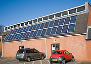Rooftop array solar panels on community centre building, Woodbridge, Suffolk, England