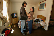 Homeless couple Dan Orozco and Jenette Solis comfort each other while trying to navigate the Portland housing network. They have taken up temporary residence in a room at the Budget Motel on Interstate Avenue though funds are beginning to run low and they'll be on the street again by the end of the week. ..