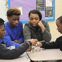 RAY VAN DUSEN/BUY AT PHOTOS.MONROECOUNTYJOURNAL.COM<br /> Resource Managment From left, Marquavise Crump, Kaleb Jones, Ashley Short and Tamera Brandon work to complete an education versus income tower project in Elisabeth Oliver's resource management class at Aberdeen High School. Students in groups drew sheets at random to indicate their fictitious education level from high school dropout to holders of doctorate degrees. The education level they drew gave them privilege to speak and/or use one or two hands in constructing a free-standing tower made from toothpicks and marshmallows. Oliver also teaches a family dynamics class.