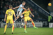Jonathan Hogg (Huddersfield Town) watches as his header goes wide of the goal during the Sky Bet Championship match between Huddersfield Town and Rotherham United at the John Smiths Stadium, Huddersfield, England on 15 December 2015. Photo by Mark P Doherty.