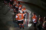 The RIT Men's Hockey team is introduced before a game against Brock University at the Gene Polisseni Center on Saturday, October 4, 2014.