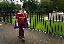 © Licensed to London News Pictures. 09/05/2012. Westminster, UK A man dressed as a soldier makes his way through St James Park. The procession carrying Queen Elizabeth II on its way to the Palace of Westminster today 9th May 2012. It is the first Queen's Speech, the grandest event on the parliamentary calendar, since shortly after the coalition Government was formed. The statement usually takes place each autumn. Photo credit : Stephen Simpson/LNP