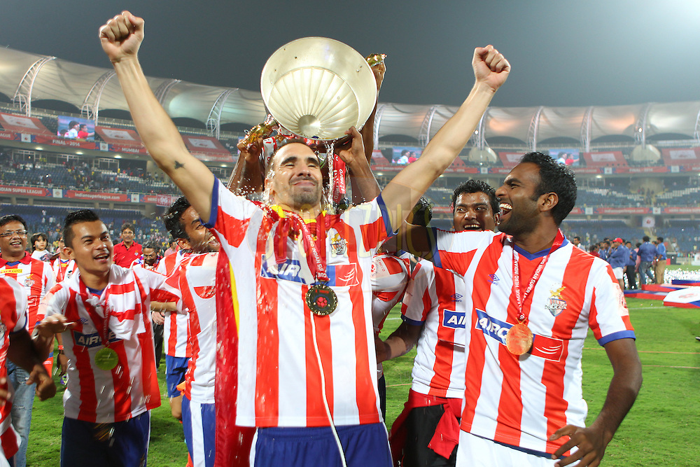 Kolkata celebrate the win during the final of the Hero Indian Super League between Kerala Blasters FC and Atletico de Kolkata held at the D.Y. Patil Stadium, Navi Mumbai, India on the 20th December 2014.<br /> <br /> Photo by:  Ron Gaunt / ISL/ SPORTZPICS