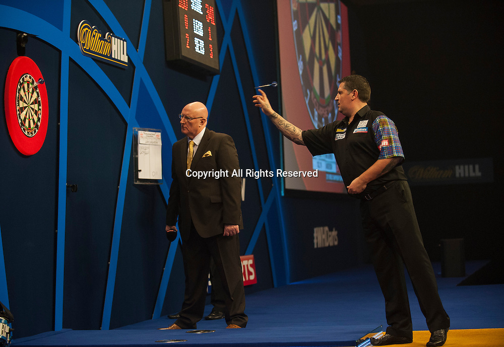 03.01.2015.  London, England.  William Hill PDC World Darts Championship.  Semi Final Round. Gary Anderson (4) [SCO] takes an early lead in his match against Michael van Gerwen (1) [NED]
