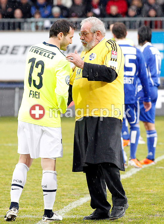 Former FC Luzern player Paul WOLFISBERG (R), who played his first match 60 years ago, talks to FC Basel player Alex Frei after kicking off the AXPO Super League (National League A) soccer match between FC Luzern (FCL) and FC Basel (FCB) at the Gersag stadium in Emmenbruecke, Switzerland, Sunday, February 27, 2011. (Photo by Patrick B. Kraemer / MAGICPBK)