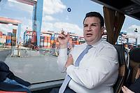 16 JUL 2018, HAMBURG/GERMANY:<br /> Hubertus Heil, SPD, Bundesarbeitsminister, faehrt in einem Bus ueber das Gelaende des  Container Terminal Altenwerder, CTA, der Hamburger Hafen und Logistik Aktiengesellschaft, HHLA, im Rahmen der Sommerreise von Hubertus Heil<br /> IMAGE: 20180716-01-100