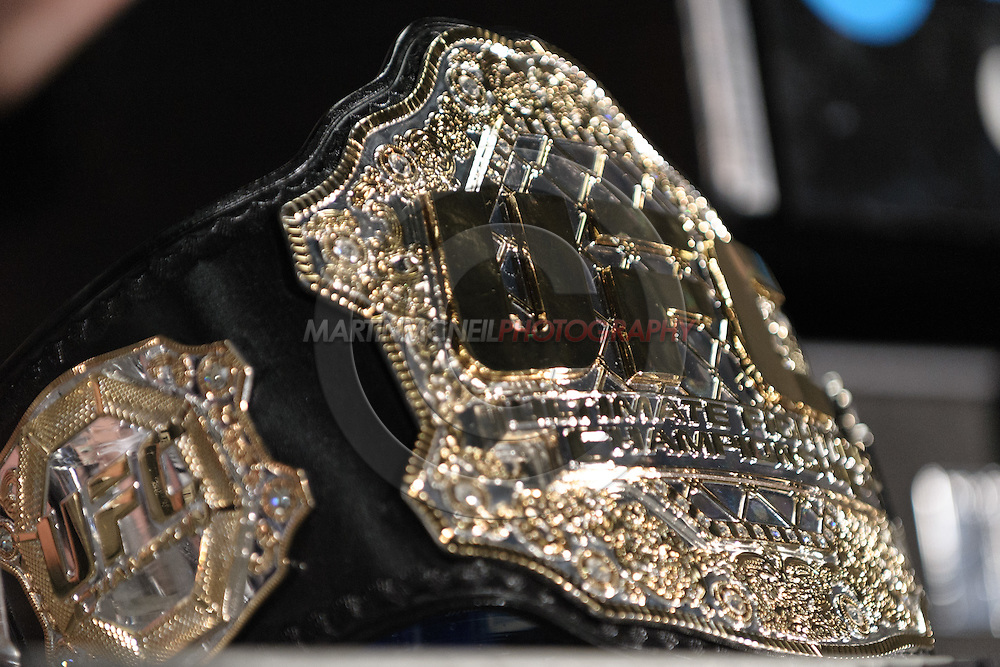"NEWARK, NEW JERSEY, MARCH 28, 2010: The UFC welterweight title belt sits on a table at the post-fight press conference for ""UFC 111: St. Pierre vs. Hardy"" in the Prudential Center, New Jersey on March 28, 2010."