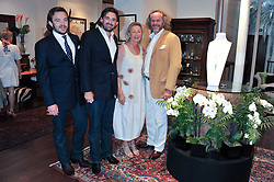 Left to right, ALEXANDER MAVROS, FORBES MAVROS and PATRICK & CATJA MAVROS at a party to celebrate the launch of the new Mauritius Collection of jewellery by Forbes Mavros held at Patrick Mavros, 104-106 Fulham Road, London SW3 on 5th July 2011.