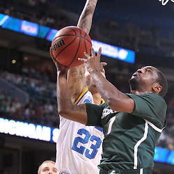 Mar 17, 2011; Tampa, FL, USA; Michigan State Spartans guard Kalin Lucas (1) shoots over UCLA Bruins forward Tyler Honeycutt (23) during the first half of the second round of the 2011 NCAA men's basketball tournament at the St. Pete Times Forum.  Mandatory Credit: Derick E. Hingle