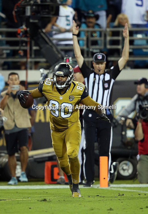 Jacksonville Jaguars tight end Julius Thomas (80) starts to celebrate after catching a fourth quarter touchdown that gives the Jaguars a 16-13 lead during the 2015 week 11 regular season NFL football game against the Tennessee Titans on Thursday, Nov. 19, 2015 in Jacksonville, Fla. The Jaguars won the game 19-13. (©Paul Anthony Spinelli)