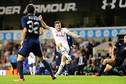Tottenham Hotspur's Gylfi Sigurosson takes a shot at goal. - Photo mandatory by-line: Dougie Allward/JMP - Tel: Mobile: 07966 386802 27/08/2013 - SPORT - FOOTBALL - White Hart Lane - London - Tottenham Hotspur V Dinamo Tbilisi -  UEFA EUROPA LEAGUE - PLAY-OFF - SECOND LEG