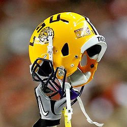 Dec 3, 2011; Atlanta, GA, USA; LSU Tigers cornerback Ron Brooks (13) holds up his helmet during the first half of the 2011 SEC championship game against the Georgia Bulldogs at the Georgia Dome.  Mandatory Credit: Derick E. Hingle-US PRESSWIRE