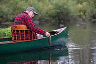 Angler Matson Holbrook lands a native Brook trout from the Upper Brule River near Lake Nebagamon, Wisconsin, in a 1900-era Lucius guide canoe meticulously restored over the course of two years by Brule Guide Damian Wilmot.