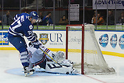 Rochester Americans goaltender Nathan Lieuwen stops a breakaway shot by Marlies forward Casey Bailey during a game in Rochester, New York, USA on Friday, December 4, 2015.