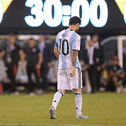 EAST RUTHERFORD, NEW JERSEY - JUNE 26:  Lionel Messi #10 of Argentina walks back to the half way line after missing his penalty kick in the penalty shoot out during the Argentina Vs Chile Final match of the Copa America Centenario USA 2016 Tournament at MetLife Stadium on June 26, 2016 in East Rutherford, New Jersey. (Photo by Tim Clayton/Corbis via Getty Images)