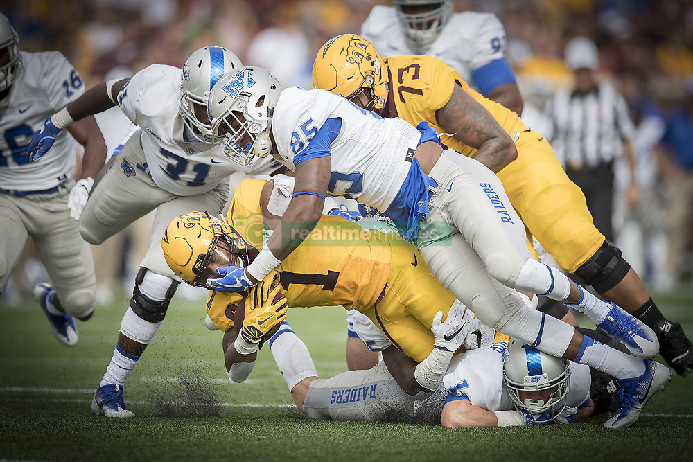 September 16, 2017 - Minneapolis, MN, USA - Minnesota running back Rodney Smith (1) is brought down after a short gain by Middle Tennessee defensive end Darrius Liggins during the first quarter at TCF Bank Stadium, Saturday, Sept. 16, 2017, in Minneapolis. The host Gophers won, 34-3. (Credit Image: © Elizabeth Flores/TNS via ZUMA Wire)