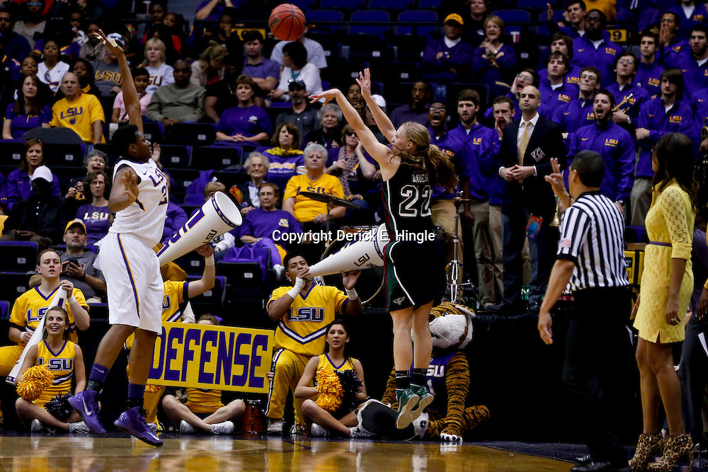 Mar 24, 2013; Baton Rouge, LA, USA; Green Bay Phoenix forward Lydia Bauer (22) shoots over LSU Tigers forward Shanece McKinney (23) in the first half of the first round of the 2013 NCAA womens basketball tournament at the Pete Maravich Assembly Center.  Mandatory Credit: Derick E. Hingle-USA TODAY Sports
